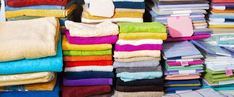 Detail view of cotton loop towels and bed sheets in textile store