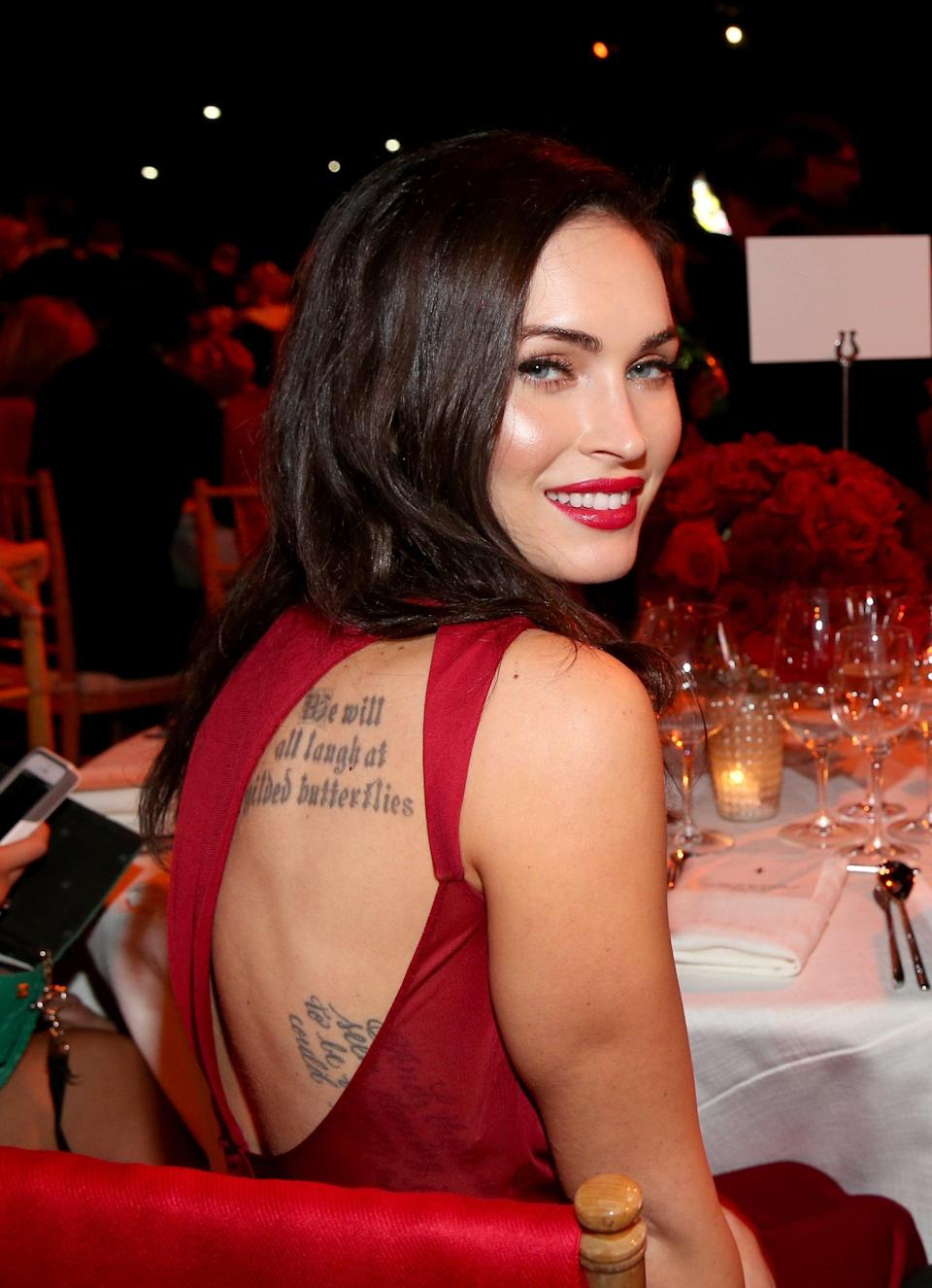 """<p>On the right side of her back, Fox has a quote by philosopher, poet, and composer Friedrich Nietzsche. It goes vertically down her ribs and reads, """"And those who were seen dancing were thought to be insane by those who could not hear the music."""" She got it before June of 2010.</p>"""
