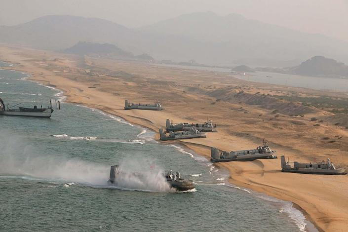 <p>Landing and anti-landing exercises at an unknown location, March 20, 2016. (KCNA/Reuters) </p>