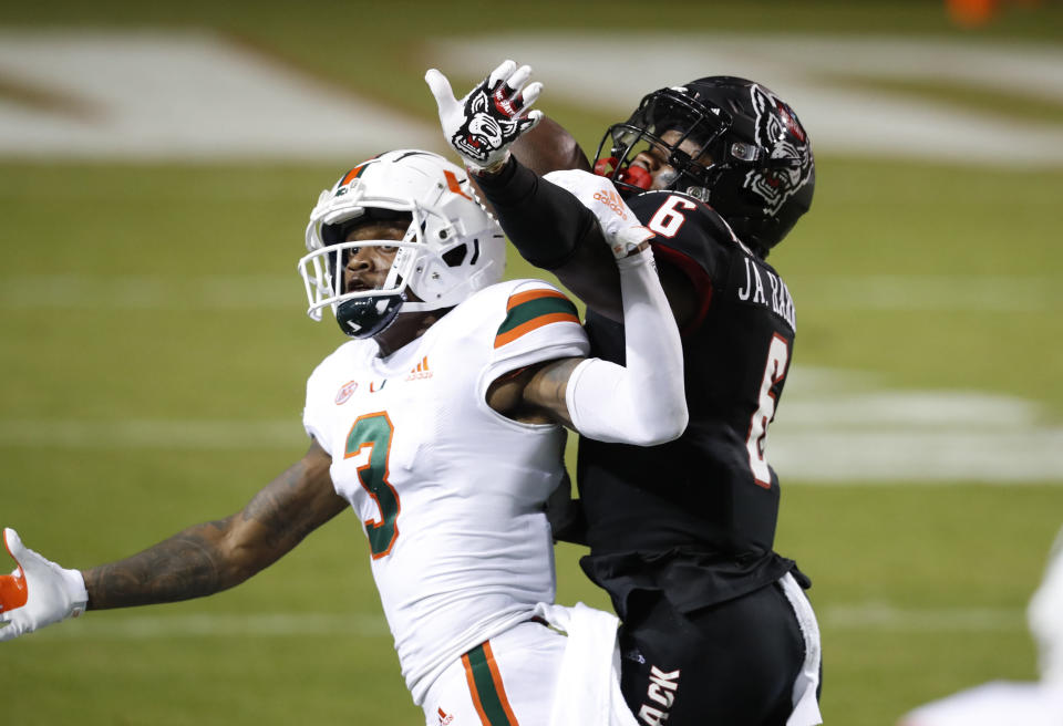 North Carolina State safety Jakeen Harris defends against Miami wide receiver Mike Harley (3) during the first half of an NCAA college football game Friday, Nov. 6, 2020, in Raleigh, N.C. Harris was called for pass interference. (Ethan Hyman/The News & Observer via AP, Pool)