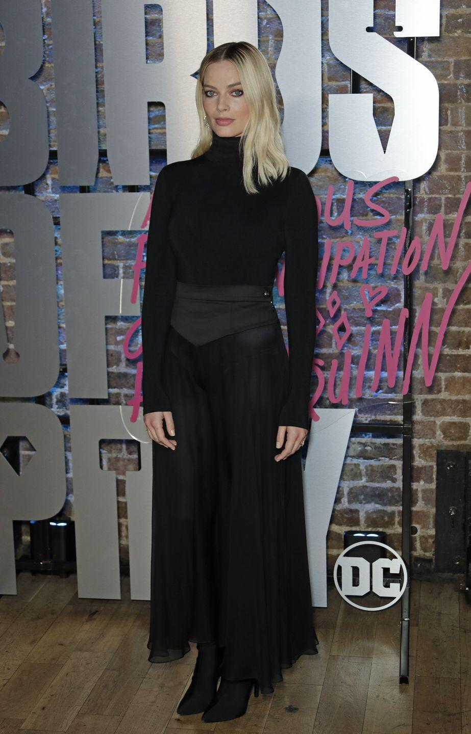 <p>The actress attended the UK photocall for her latest film Birds of Prey wearing a black roll neck, midi skirt and black pointed-toe boots. </p>