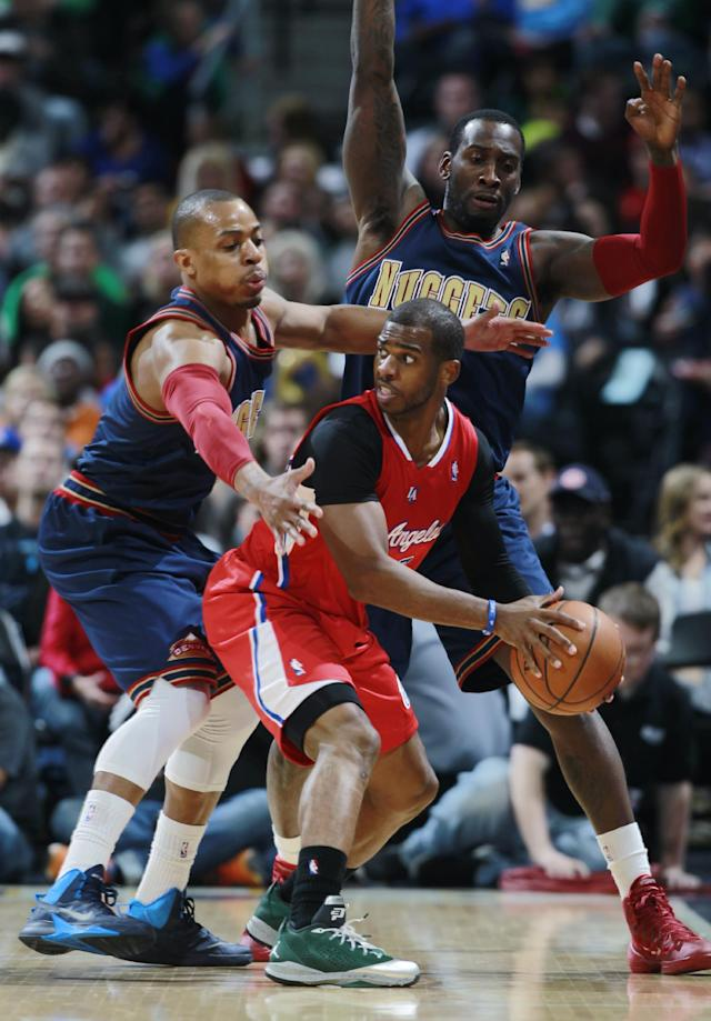 Los Angeles Clippers guard Chris Paul, front right, is trapped with ball by Denver Nuggets guard Randy Foye, front left, and forward J.J. Hickson in the second quarter of the Nuggets' 110-100 victory in an NBA basketball game in Denver on Monday, March 17, 2014. (AP Photo/David Zalubowski)