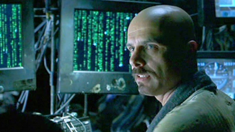 Joe Pantoliano causing mischief in The Matrix (Image by Warner Bros)