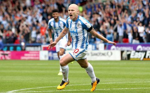 Aaron Mooy of Huddersfield Town celebrates scoring - Credit: Getty
