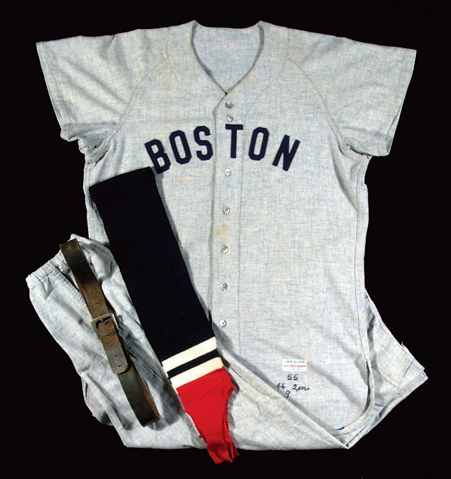 "Ted Williams' 1955 Boston Red Sox professional model road jersey is worth an estimated $75,000 to $100,000. The grey flannel jersey displays its original ""Boston"" team name across the front and #9 on the reverse."