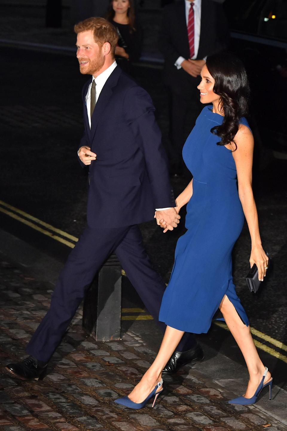 <p>For a charity gala concert at Central Hall Westminster, the Duchess of Sussex chose a royal blue midi stress by Jason Wu. She accessorised the look with co-ordinating Aquazurra heels and her go-to bespoke Dior clutch. In a surprising move, she ditched her now-trademark messy bun in favour of Duchess-worthy curls. <em>[Photo: PA]</em> </p>