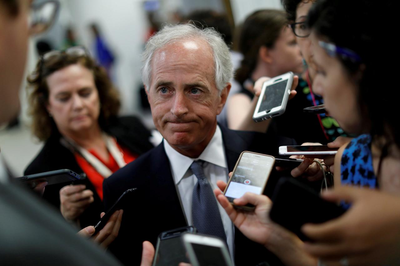 FILE PHOTO: Senator Bob Corker (R-TN) speaks with reporters about the withdrawn Republican health care bill on Capitol Hill in Washington, U.S., July 18, 2017. REUTERS/Aaron P. Bernstein/File Photo