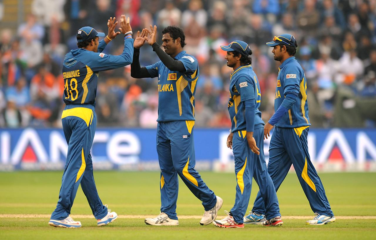 Sri Lanka's Angelo Mathews (second left) celebrates with his team mates after taking the wicket of India's Rohit Sharma (not pictured) during the ICC Champions Trophy, Semi Final at the SWALEC Stadium, Cardiff.