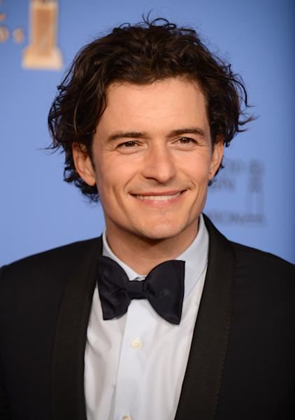 Orlando Bloom poses in the press room at the 71st annual Golden Globe Awards at the Beverly Hilton Hotel on Sunday, Jan. 12, 2014, in Beverly Hills, Calif. (Photo by Jordan Strauss/Invision/AP)