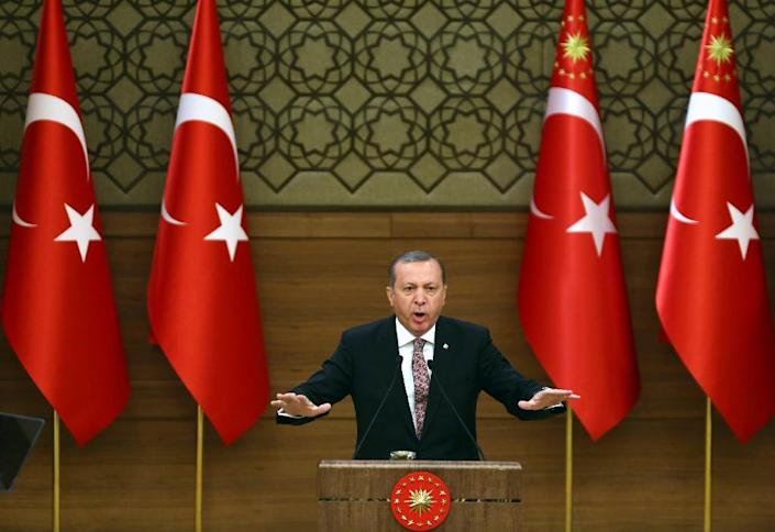 Turkish President Recep Tayyip Erdogan said on March 11, 2016 the existence of the country's top court could be in doubt after they decided to release two journalists (AFP Photo/Adem Altan)