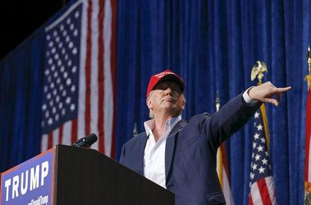 U.S. Republican presidential candidate Donald Trump motions for security to remove a person from his rally in Sarasota, Florida