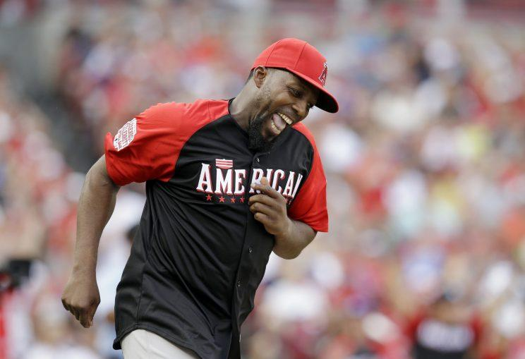 Vlad Guerrero smiles after hitting a home run during the All-Star Legends & Celebrity Softball game, Sunday, July 12, 2015, in Cincinnati. (AP Photo/John Minchillo)