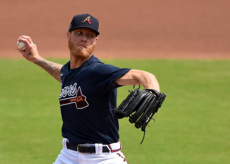Mike Foltynewicz pitching in navy jersey