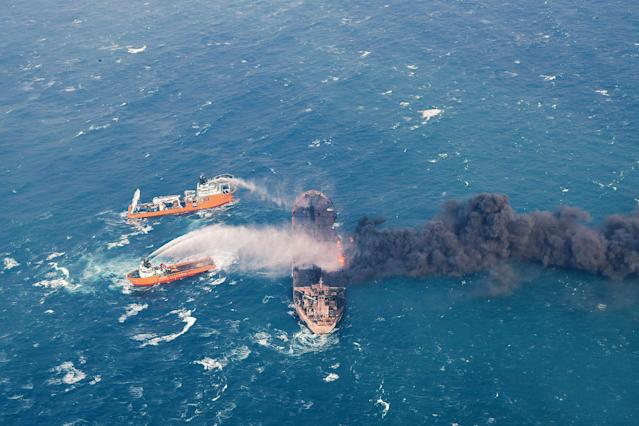 <p>Firefighting boats work to put on a blaze on the oil tanker Sanchi in the East China Sea off the eastern coast of China, Jan. 10, 2018. Rescue ships looking for missing crew members from the oil tanker Sanchi have expanded their search area to more than 2,600 square kilometers (1,000 square miles) as Chinese state television reported Friday that maritime authorities still have not found any survivors, or put out the blaze onboard the ship. (Photo: Ministry of Transport via AP) </p>