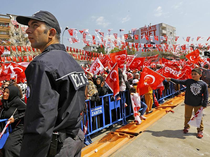 Erdogan supporters wave national flags and Yes campaign flags at a rally ahead of the referendum: Reuters