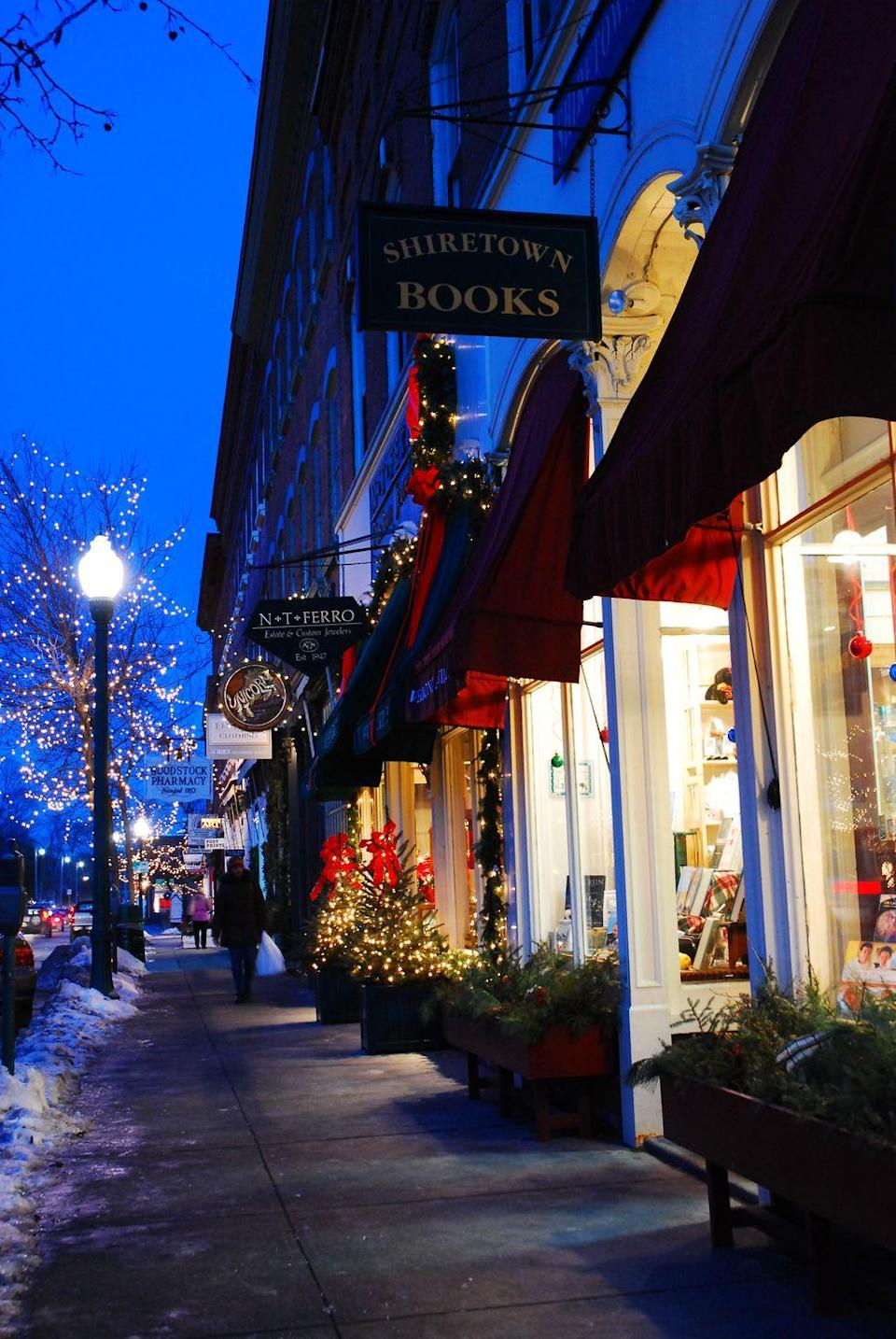 """<p>Not only is Woodstock a picturesque town year-round, it's absolutely breathtaking during the holiday season. Every year, in mid-December, Woodstock holds its <a href=""""https://www.woodstockvt.com/events/wassail-weekend"""" rel=""""nofollow noopener"""" target=""""_blank"""" data-ylk=""""slk:Wassail Weekend"""" class=""""link rapid-noclick-resp"""">Wassail Weekend</a>, complete with caroling, twinkling lights, historic decorated homes, and unique local shops filled with gifts for everyone.. You can take wagon rides throughout the town and see the next-level holiday decorations at Billings Farm.</p>"""