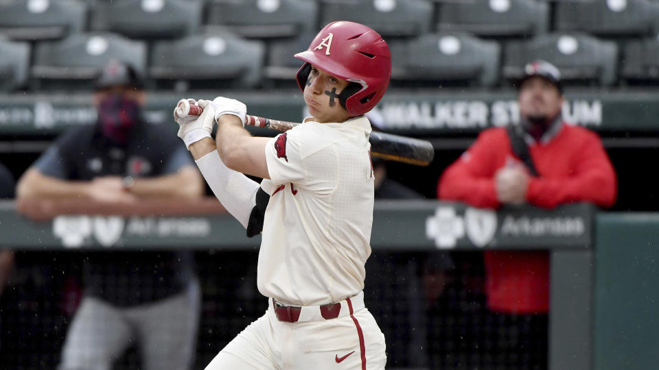 FILE - Arkansas batter Robert Moore bats against Southeast Missouri State during an NCAA baseball game in Fayetteville, Ark., in this Sunday, Feb. 28, 2021, file photo. Top-ranked Arkansas is closing in on its first SEC championship in baseball since 2004 after winning two of three one-run games at Tennessee. (AP Photo/Michael Woods, File)