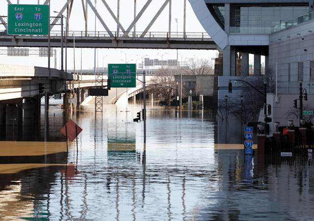 <p>Water covers River Road in downtown Louisville and the on and off ramps to Interstate 64 after the Ohio River flooded Louisville, Ky., Feb. 26, 2018. (Photo: John Sommers II/Reuters) </p>