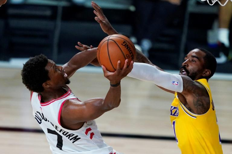 Toronto's Kyle Lowry, left, drives to the hoop against J.R. Smith of the Los Angeles Lakers in Toronto's 107-92 NBA victory Saturday