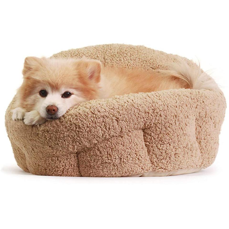 """<h3><a href=""""https://amzn.to/2KDFoLQ"""" rel=""""nofollow noopener"""" target=""""_blank"""" data-ylk=""""slk:OrthoComfort Deep Dish Pet Bed"""" class=""""link rapid-noclick-resp"""">OrthoComfort Deep Dish Pet Bed</a></h3><br><strong>Liz</strong><br><br><strong>How She Discovered It:</strong> """"Searching high and low for a cozy bed that would make my anxious pup feel at home while we are currently quarantined away from it."""" <br><br><strong>Why It's A Hidden Gem:</strong> """"My boyfriend and I call this absolute gem, 'The Snuggle Cup.' My only wish is that they made it in a human size — because we could all use a little Snuggle Cuppin' right now.""""<br><br><strong>Best Friends By Sheri</strong> Best Friends by Sheri OrthoComfort Deep Dish Cuddler, $, available at <a href=""""https://amzn.to/2KDFoLQ"""" rel=""""nofollow noopener"""" target=""""_blank"""" data-ylk=""""slk:Amazon"""" class=""""link rapid-noclick-resp"""">Amazon</a>"""