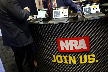 People sign up at the booth for the National Rifle Association (NRA) at the Conservative Political Action Conference (CPAC) at National Harbor, Maryland