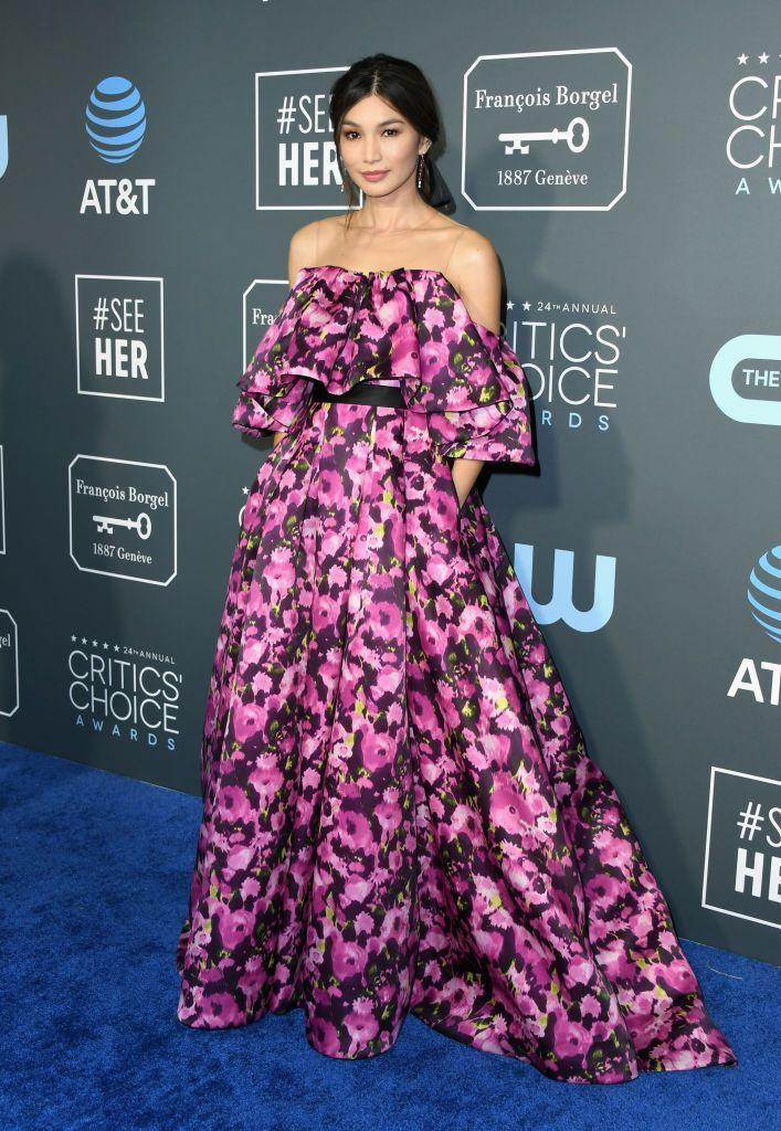 <p>The actor looked radiant in a custom off-the-shoulder floral red carpet gown by Jason Wu.</p>