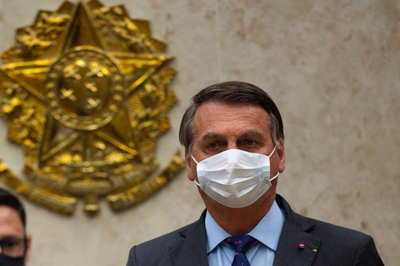 BRASILIA, BRAZIL - SEPTEMBER 10: President of Brazil Jair Bolsonaro attends the inauguration ceremony of the new Supreme Court President Luiz Fux amidst the coronavirus (COVID-19) pandemic at the  on September 10, 2020 in Brasilia. Brazil has over 4.197,000 confirmed positive cases of Coronavirus and has over 128,539 deaths. (Photo by Andressa Anholete/Getty Images)