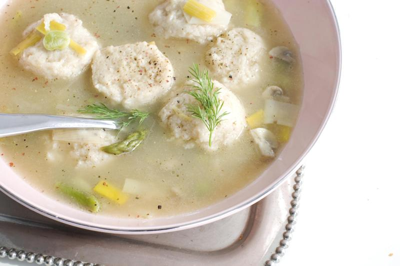 In this March 4, 2013 photo, spring vegetable soup with low-fat, high-flavor matzo balls is shown served in a bowl in Concord, N.H. (AP Photo/Matthew Mead)