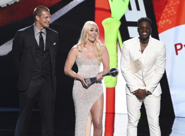 Rob Gronkowski, from left, Lindsey Vonn, and Dwyane Wade accept their awards for best moment at the ESPY Awards on Wednesday, July 10, 2019, at the Microsoft Theater in Los Angeles. (Photo by Chris Pizzello/Invision/AP)