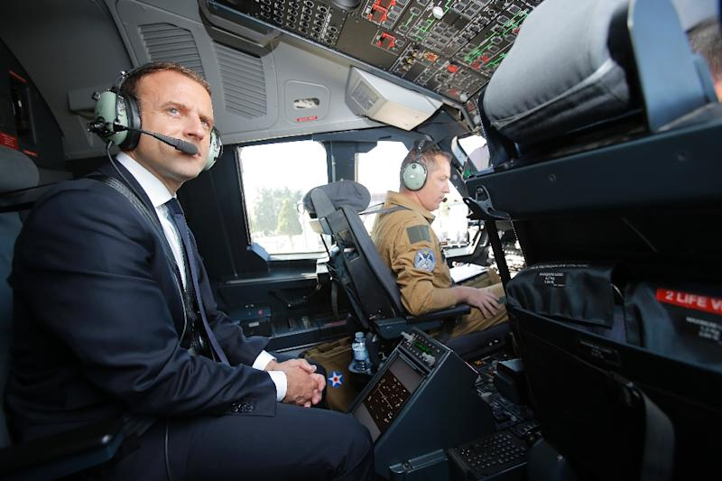 French President Emmanuel Macron in the cockpit of an Airbus A400M turboprop transport plane before travelling to the Paris Air Show (AFP Photo/Michel Euler)