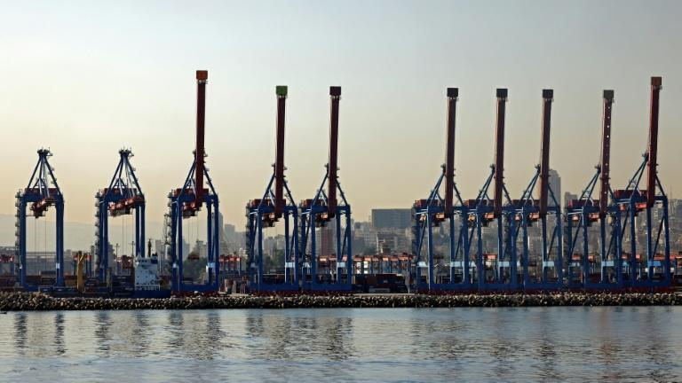 Cranes are pictured on October 26, 2020 at Beirut port; this month, a company has been clearing 52 containers of chemicals stored there for years