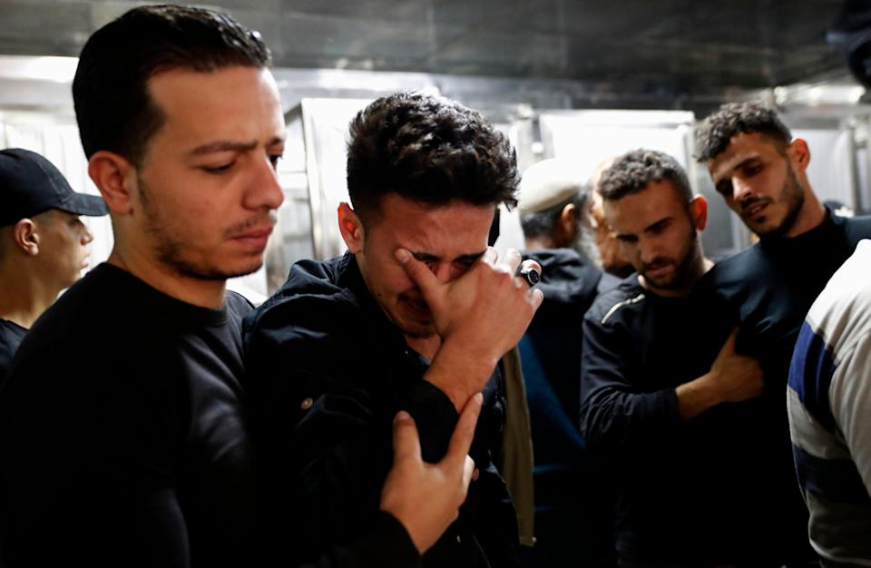 Relatives mourn during the funeral of Reema Telbani and her 5-year-old son Zaid, who were killed in Israeli airstrikes on an apartment building in GazaAP