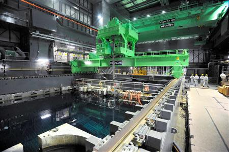 Kyodo file photo shows crane units installed over the spent fuel pool inside the No.4 reactor building at TEPCO's Fukushima Daiichi nuclear power plant
