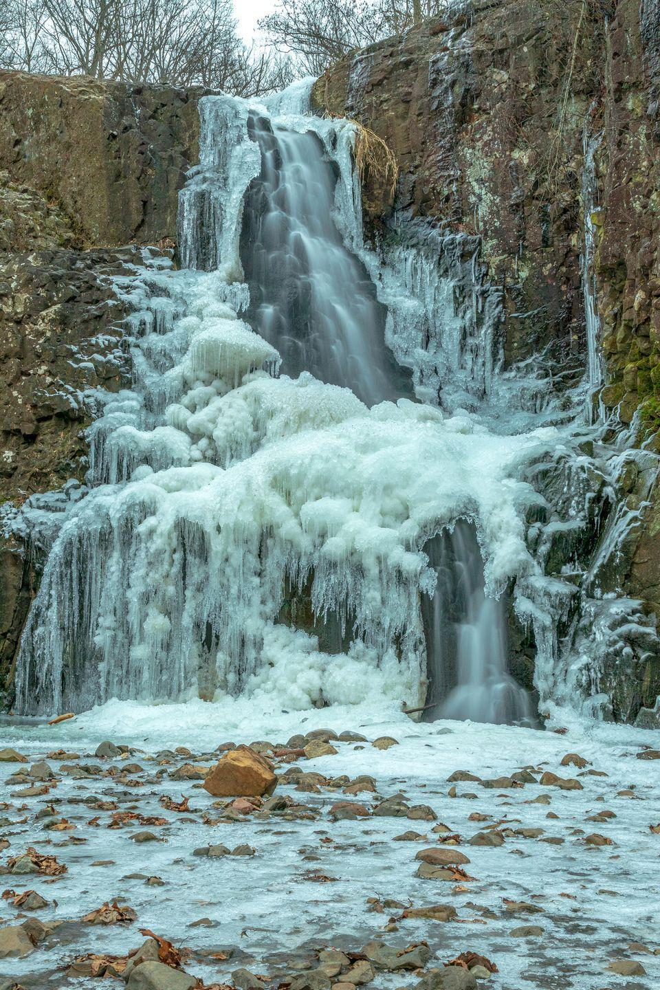 <p>It's so interesting how some of the water still flows while some parts freeze to create these precariously stunning formations. </p>