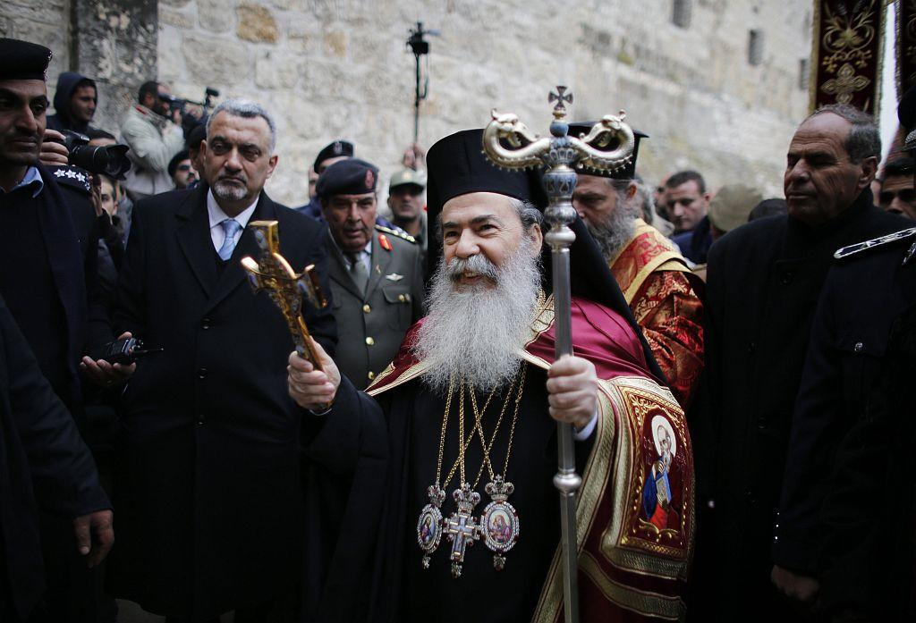 WEST BANK: Greek Orthodox Patriarch of Jerusalem Metropolitan Theophilos (C) arrives to take part in the Eastern Orthodox Christmas procession outside the Church of the Nativity in the West Bank town of Bethlehem January 6, 2013.