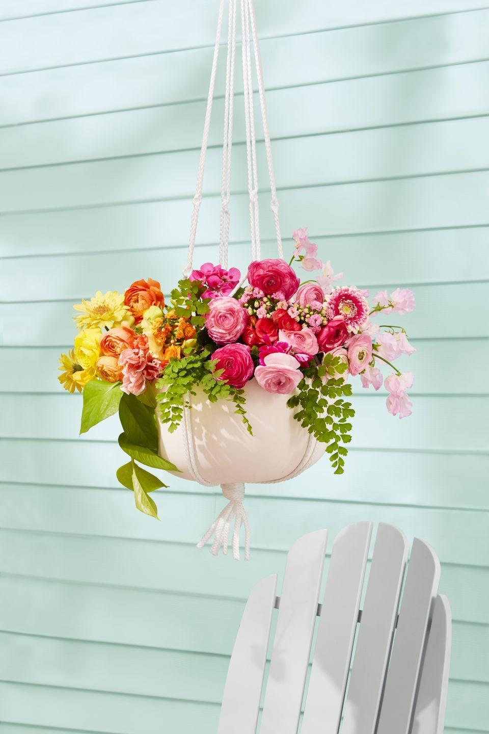 """<p>Instantly boost your home's curb appeal with <a href=""""https://www.goodhousekeeping.com/home/gardening/g2503/surprising-flower-meanings/"""" rel=""""nofollow noopener"""" target=""""_blank"""" data-ylk=""""slk:bright blooms"""" class=""""link rapid-noclick-resp"""">bright blooms</a> on each side of your front door. Expecting guests? Steal these tricks<br>from our home team: Add stems from a supermarket bouquet for extra fullness and mint for a fragrant burst.</p>"""