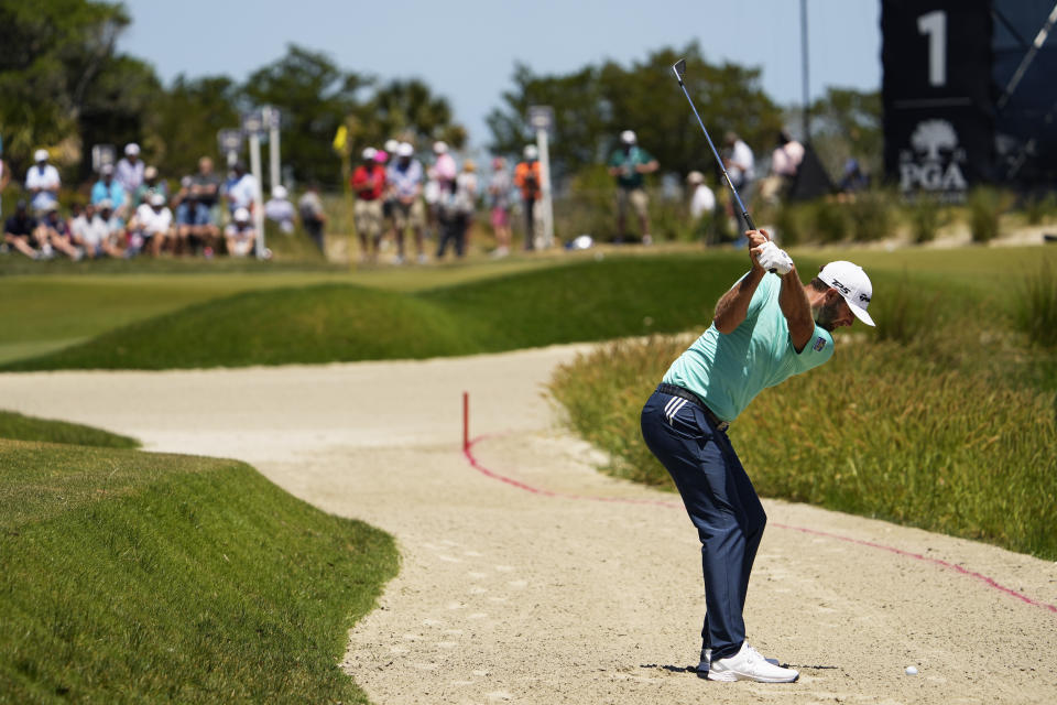 Dustin Johnson takes his second shot on the first hole during the first round of the PGA Championship golf tournament on the Ocean Course Thursday, May 20, 2021, in Kiawah Island, S.C. (AP Photo/David J. Phillip)