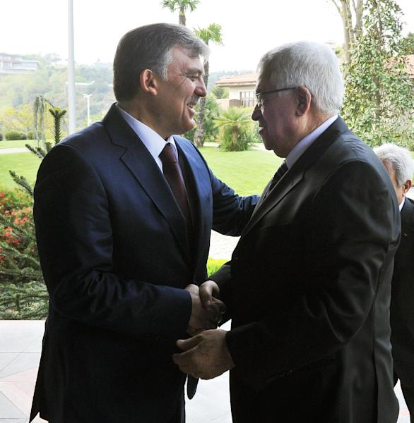 In this photo provided by Turkish Presidency Press Service,Turkey's President Abdullah Gul, left, greets Palestinian leader Mahmoud Abbas before a meeting in Ankara, Turkey, Monday, April 22, 2013. U.S. Secretary of State John Kerry met with Abbas Sunday in Istanbul, in an effort to relaunch Mideast peace efforts, one of President Barack Obama's foreign policy priorities.(AP Photo/irfan Yildiz)