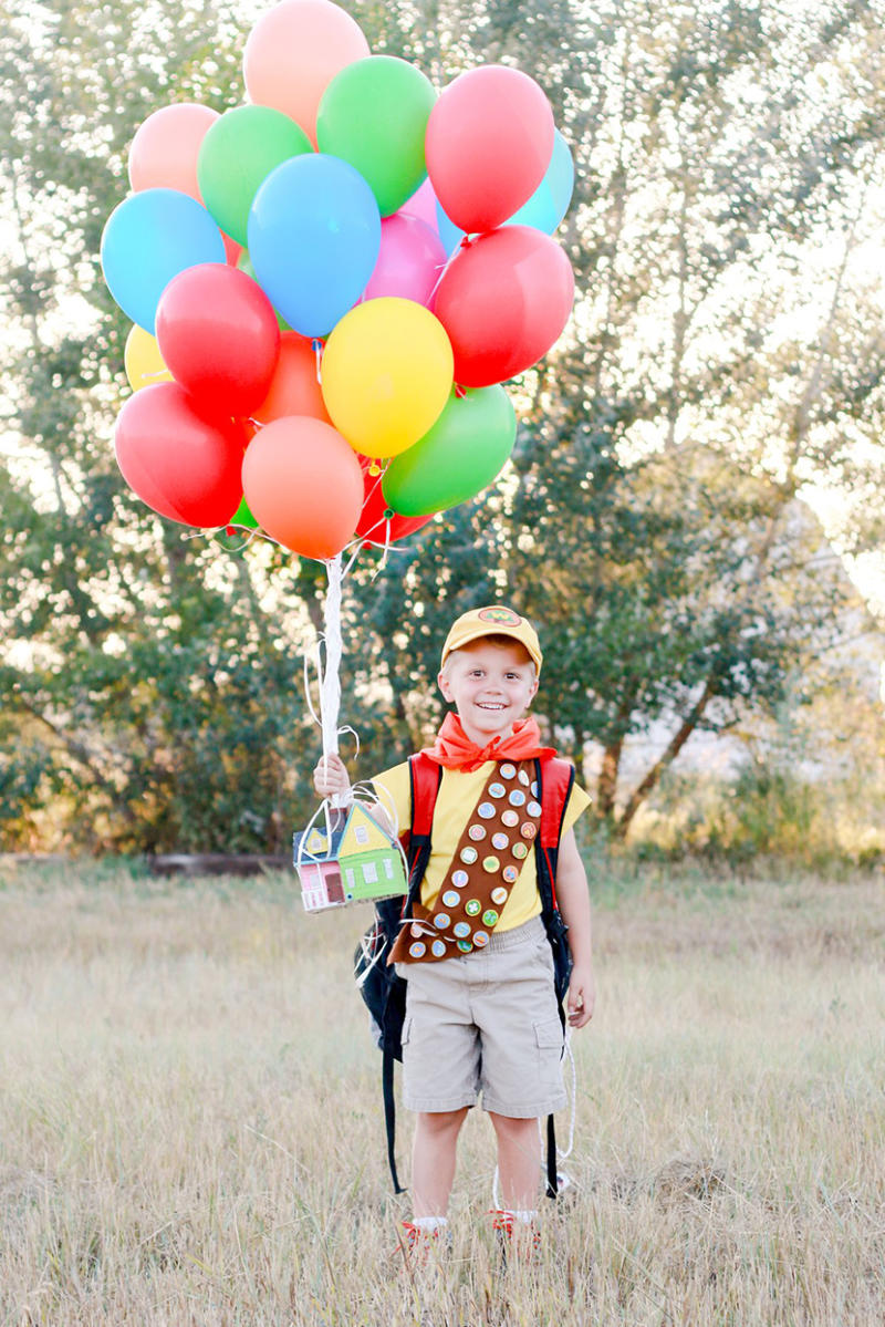 young boy dressed as character form Up