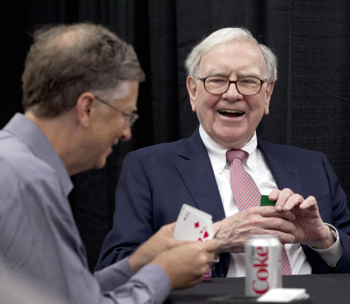 Warren Buffett, chairman and CEO of Berkshire Hathaway, right, jokes with Microsoft's Bill Gates as they play bridge in Omaha, Neb., Sunday, May 6, 2012. Berkshire Hathaway is holding its annual shareholders meeting this weekend. (AP Photo/Nati Harnik)
