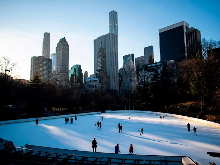 <p>People skate on the Wollman Rink in Central Park in the early morning hours of  27 January 2019 in New York City</p> ((AFP via Getty Images))