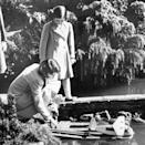 <p>Elizabeth plays with her sister in Buckinghamshire (PA Archive) </p>