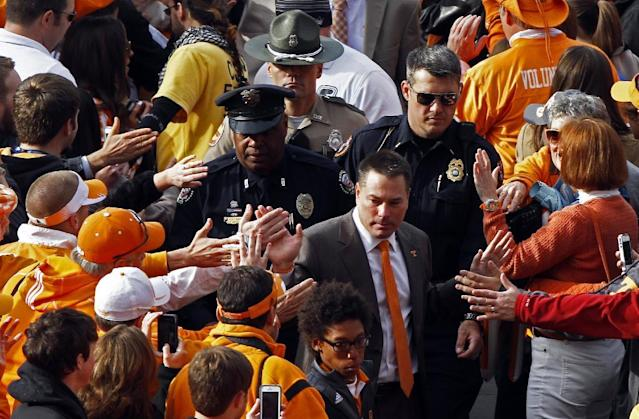 Tennessee head coach Butch Jones makes his way through fans during the Vol Walk before an NCAA college football game against Auburn on Saturday, Nov. 9, 2013 in Knoxville, Tenn. (AP Photo/Wade Payne)