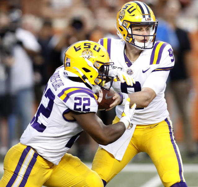 LSU Tigers running back Clyde Edwards-Helaire #22 takes the hand off from LSU Tigers quarterback Joe Burrow #9 Saturday Sept. 7, 2019 at Darrell K Royal-Texas Memorial Stadium in Austin, Tx. ( Photo by Edward A. Ornelas )