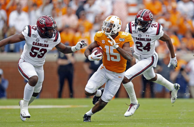 Tennessee wide receiver Jauan Jennings (15) runs for yardage as he's chased by South Carolina linebacker Ernest Jones (53) and defensive back Israel Mukuamu (24) in the first half of an NCAA college football game, Saturday, Oct. 26, 2019, in Knoxville, Tenn. (AP Photo/Wade Payne)