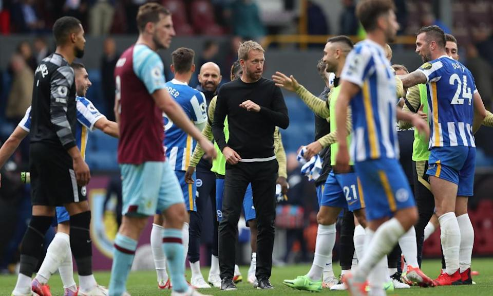 Graham Potter celebrates with his players after Brighton's win at Burnley