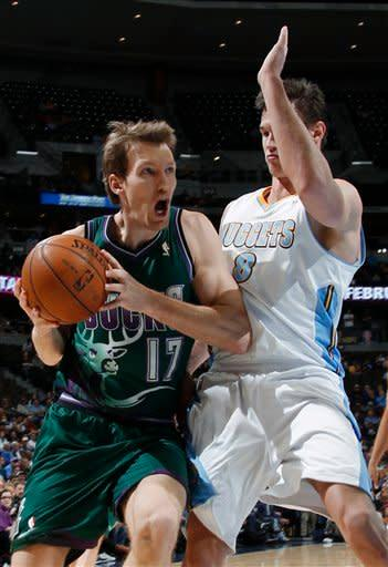Milwaukee Bucks forward Mike Dunleavy, left, works against Denver Nuggets forward Danilo Gallinari, of Italy, during the first quarter of an NBA basketball game in Denver on Tuesday, Feb. 5, 2013. (AP Photo/David Zalubowski)