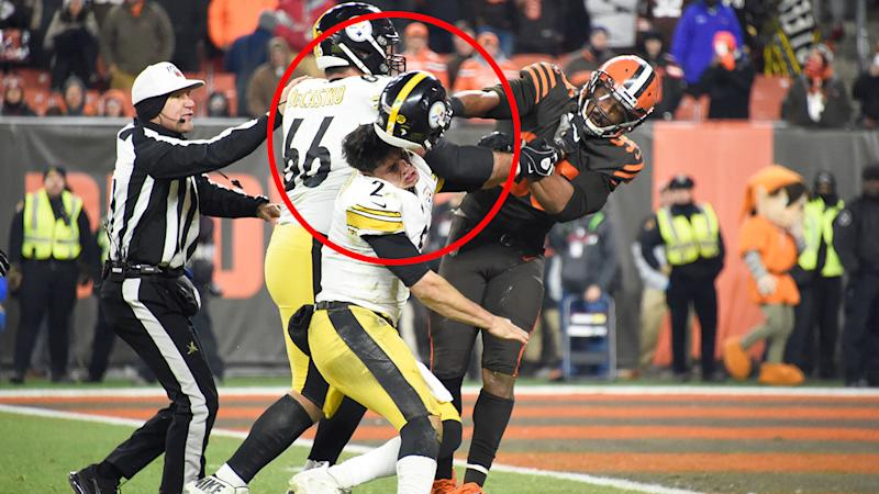 Myles Garrett can be seen whacking Mason Rudolph in the head with his own helmet.