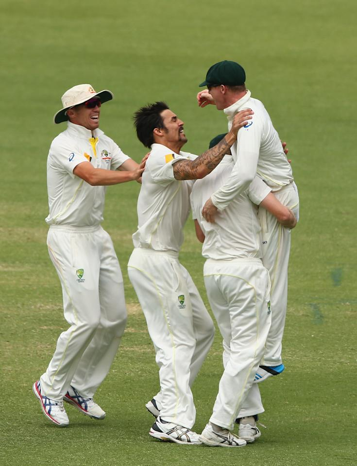 PERTH, AUSTRALIA - DECEMBER 17:  Mitchell Johnson of Australia celebrates with Chris Rogers after the combined to dismiss Tim Bresnan of England during day five of the Third Ashes Test Match between Australia and England at WACA on December 17, 2013 in Perth, Australia.  (Photo by Robert Cianflone/Getty Images)