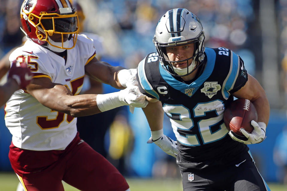 Carolina Panthers running back Christian McCaffrey (22) runs the ball while Washington Redskins free safety Montae Nicholson (35) chases during the first half of an NFL football game in Charlotte, N.C., Sunday, Dec. 1, 2019. (AP Photo/Brian Blanco)